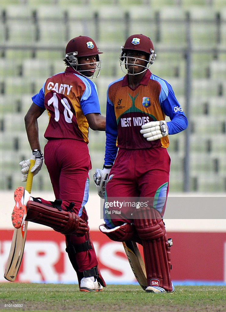 Keacy Carty of West Indies U19 and Keemo Paul of West Indies U19 run between the wickets during the ICC U19 World Cup Final Match between India and West Indies on February 14, 2016 in Dhaka, Bangladesh.