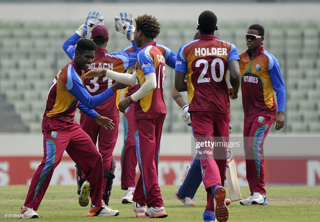 Keacy Carty of West Indies U19 and Keemo Paul of West Indies U19 celebrate the wicket of Mayank Dagar of India during the ICC U19 World Cup Final Match between India and West Indies on February 14, 2016 in Dhaka, Bangladesh.