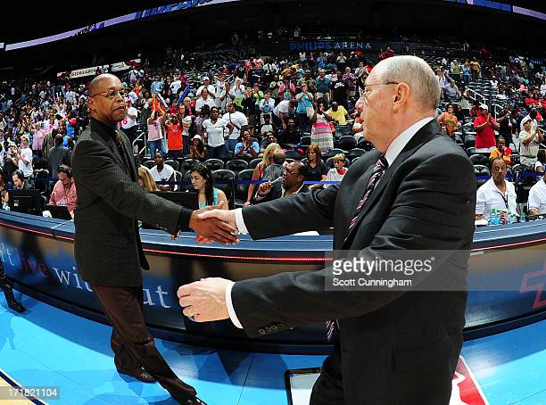 Kead Coach Fred Williams of the Atlanta Dream greets Head Coach Mike Thibault of the Washington Mystics after the game at Philips Arena on June 28...