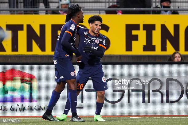 Keagan Dolly of Montpellier and Isaac Mbenza of Montpellier celebrates scoring his goa during the Ligue 1 match between As Nancy Lorraine and...