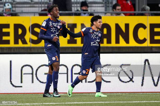 Keagan Dolly of Montpellier and Isaac Mbenza of Montpellier celebrates scoring his goal during the Ligue 1 match between As Nancy Lorraine and...