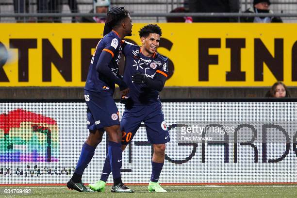 Keagan Dolly of Montpellier and Nicolas Saint Ruf of Montpellier celebrates scoring his goa during the Ligue 1 match between As Nancy Lorraine and...