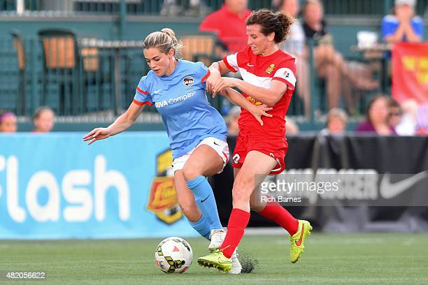 Kealia Ohai of the Houston Dash and Elizabeth Eddy of the Western New York Flash battle for a loose ball during the first half at Sahlen's Stadium on...