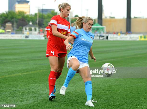 Kealia Ohai of the Houston Dash controls a loose ball in front of Abigail Dahlkemper of the Western New York Flash during the first half at Sahlen's...