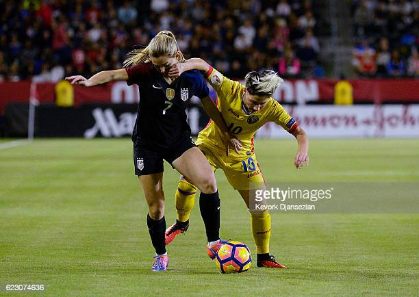 Kealia Ohai of United States and Andreea Voicu of Romania battle for the ball during the first half of their friendly soccer match at StubHub Center...