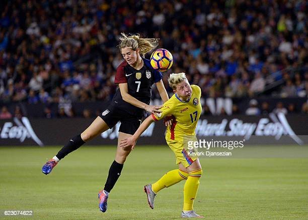 Kealia Ohai of United States and Mara Batea of Romania battle for the ball during the first half of their friendly soccer match at StubHub Center on...