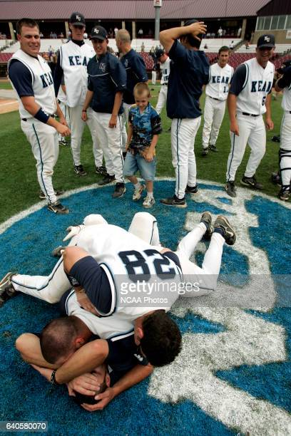 Kean baseball players celebrate on the NCAA logo after winning the division 3 championship in the tenth inning of the NCAA Division III Men's...