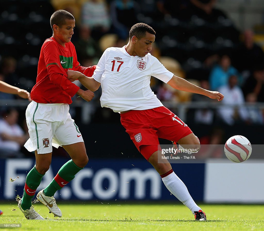 Kean Bryan of England and Clever of Portugal challenge for the ball during the match between England U17 and Portugal U17 at Pirelli Stadium on September 2, 2012 in Burton-upon-Trent, England.