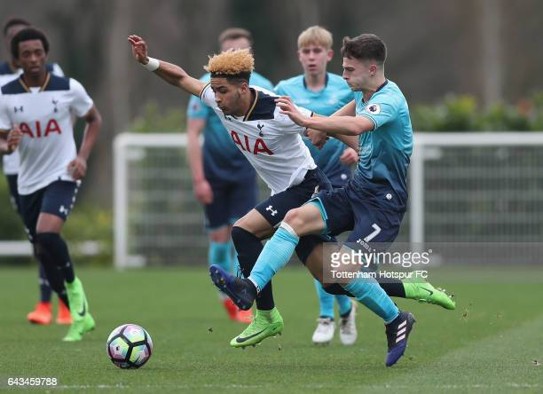 Keanan Bennetts of Spurs battles with Finley Hazell of Swansea during the U18 Premier League match between Tottenham Hotspur and Swansea City at...