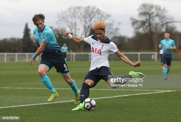 Keanan Bennetts of Spurs crosses past Joe Lewis of Swansea during the U18 Premier League match between Tottenham Hotspur and Swansea City at...