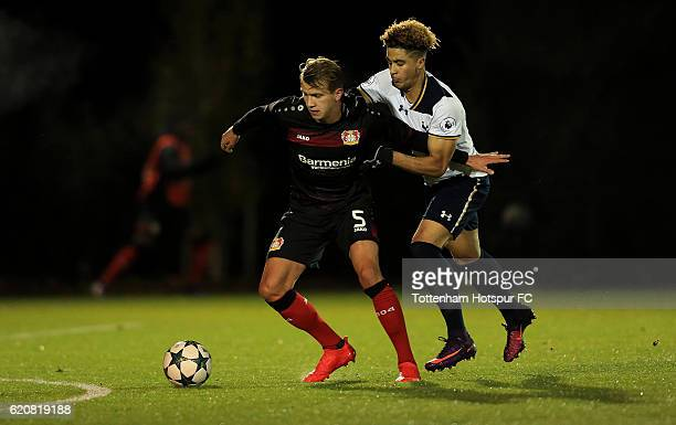 Keanan Bennetts of Tottenham Hotspur competes for the ball with Lukas Boeder of Bayer Leverkusen during the UEFA Youth League match between Tottenham...