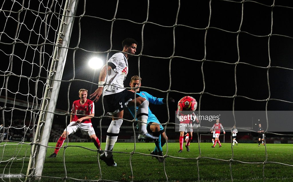 Keanan Bennetts of Tottenham Hotspur scores his side's first goal past Laurence Bilboe of Rotherham United during the FA Youth Cup match between...