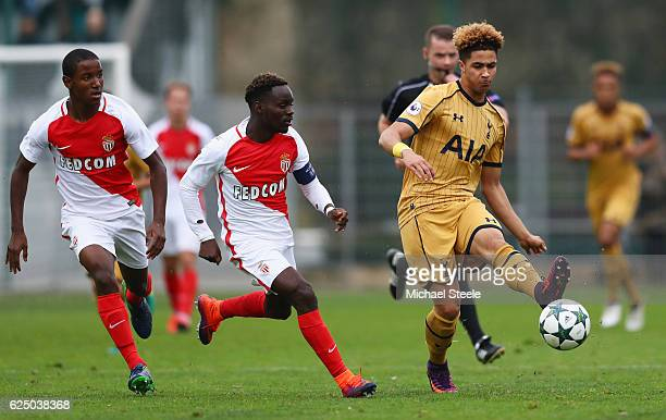 Keanan Bennetts of Tottenham Hotspur takes on Ibrahima Diallo and Tristan Muyumba of AS Monaco during the UEFA Youth Champions League match between...