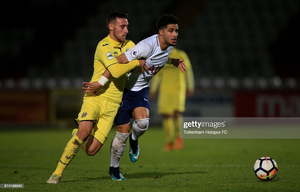 Keanan Bennetts of Tottenham is tackled by Imanol Garcia of Villarreal during the Premier League International Cup match between Tottenham Hotspur and Villarreal at The Lamex Stadium on November 14, 2017 in Stevenage, England.