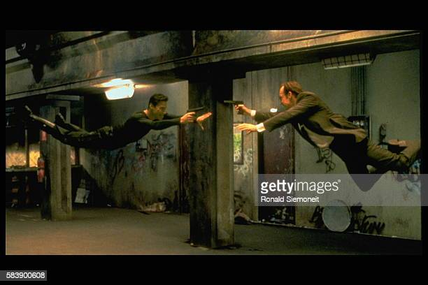 Keanu Reeves and Hugo Weaving face each other in a scene from Andy and Larry Wachowski's 1999 movie The Matrix In this scene Neo fights the...
