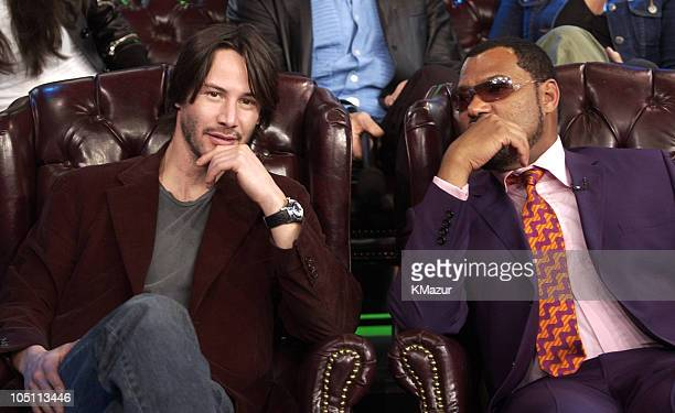 Keanu Reeves and Laurence Fishburne during The Cast of 'The Matrix Reloaded' and POD Visit MTV's 'TRL' May 5 2003 at MTV Studios Times Square in New...
