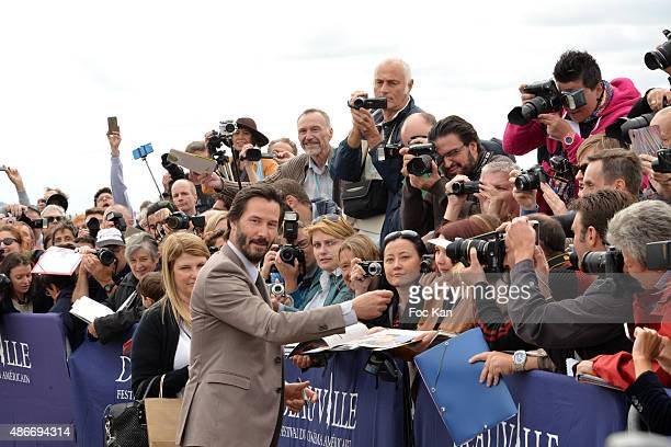 Keanu Reeves attends the Keanu Reeves photocall Call 41th Deauville American Film Festival at Les Planches de Deauville on September 4 2015 in...