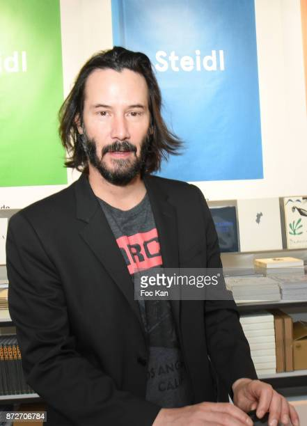 Keanu Reeves attends the Shadow Book signing on Steidle stand as part of Paris Photo 2017 Day Two At Le Grand Palais on November 10 2017 in Paris...