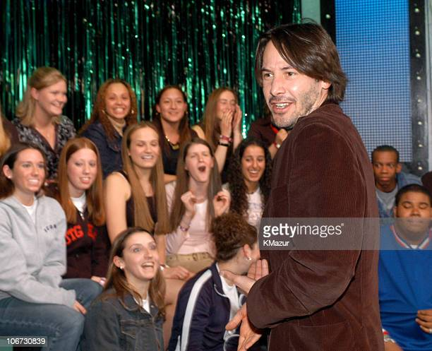 Keanu Reeves greets his fans during The Cast of 'The Matrix Reloaded' and POD Visit MTV's 'TRL' May 5 2003 at MTV Studios Times Square in New York...