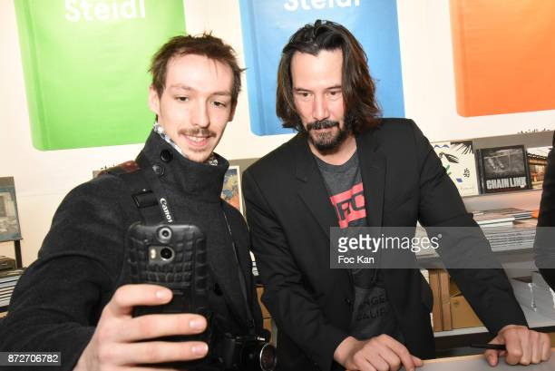Keanu Reeves poses for a selfie during the Shadow Book signing on Steidle stand as part of Paris Photo 2017 Day Two At Le Grand Palais on November 10...