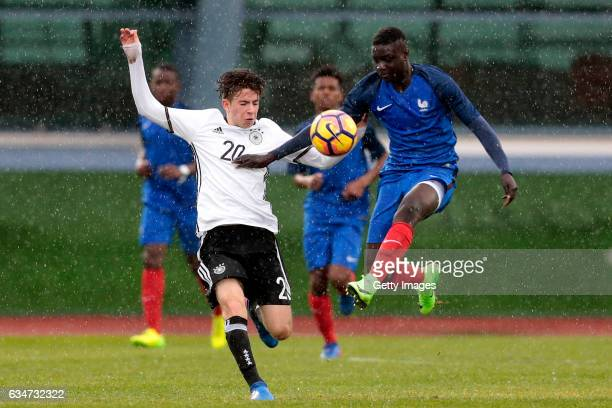 Keanu Schneider of Germany U16 challenges Abdoulaye Dabo of France U16 during the UEFA Development Tournament Match between Germany U16 and France...
