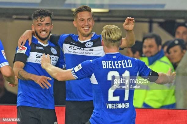 Keanu Staude Konstantin Kerschbaumer and Andreas Voglsammer of Bielefeld celebrate their teams second goal during the Second Bundesliga match between...