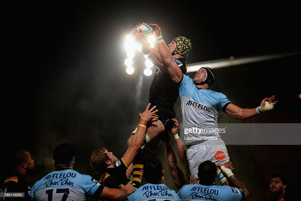 Kearnan Myall of London Wasps jumps in the lineout with <a gi-track='captionPersonalityLinkClicked' href=/galleries/search?phrase=Mark+Chisholm&family=editorial&specificpeople=226710 ng-click='$event.stopPropagation()'>Mark Chisholm</a> of Bayonne wins the lineout during the Amlin Challenge Cup round two match between London Wasps and Bayonne at Adams Park on October 17, 2013 in High Wycombe, England.