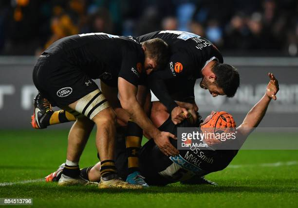 Kearnan Myall of Wasps celebrates scoring the winning try with Willie Le Roux and Jack Willis of Wasps during the Aviva Premiership match between...