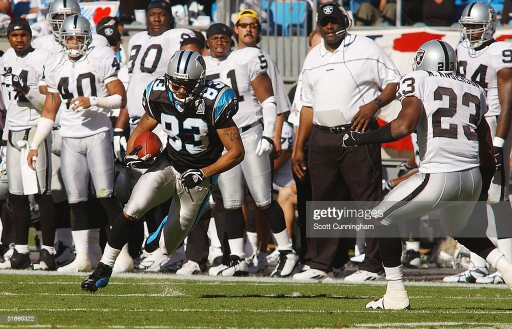 Keary Colbert #83 of the Carolina Panthers runs against the Oakland Raiders at Bank of America Stadium on November 7, 2004 in Charlotte, North Carolina. The Raiders defeated the Panthers 27-24.