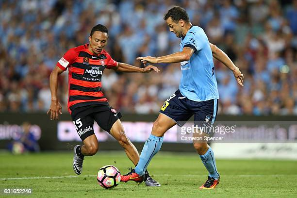 Kearyn Baccus of the Wanderers and Bobo of Sydney FC contest the ball during the round 15 ALeague match between Sydney FC and the Western Sydney...