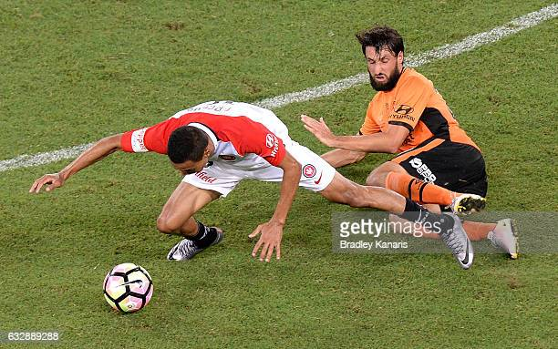 Kearyn Baccus of the Wanderers is tackled by Thomas Broich of the Roar during the round 17 ALeague match between the Brisbane Roar and the Western...