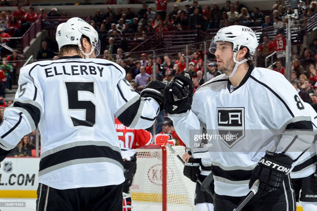 Keaton Ellerby #5 and Drew Doughty #8 of the Los Angeles Kings celebrate after the Kings scored against the Chicago Blackhawks during the NHL game on March 25, 2013 at the United Center in Chicago, Illinois.