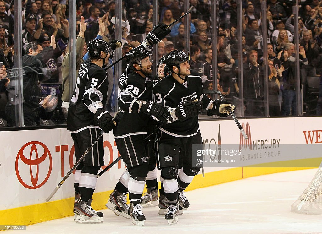 Keaton Ellerby #5, Jarret Stoll #28, Drew Doughty #8 and Kyle Clifford #13 of the Los Angeles Kings look on after celebrating a goal by Clifford in the second period during the NHL game against Columbus Blue Jackets at Staples Center on February 15, 2013 in Los Angeles, California. The Kings defeated the Blue Jackets 2-1.