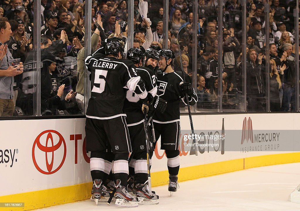 Keaton Ellerby #5, Jarret Stoll #28, Kyle Clifford #13 and Drew Doughty #8 of the Los Angeles Kings celebrate Clifford's second period goal during the NHL game against Columbus Blue Jackets at Staples Center on February 15, 2013 in Los Angeles, California. The Kings defeated the Blue Jackets 2-1.