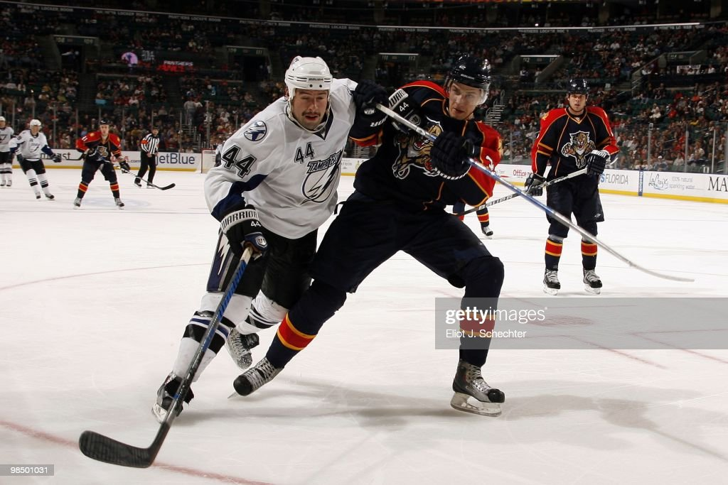 Keaton Ellerby of the Florida Panthers tangles with Nate Thompson of the Tampa Bay Lightning at the BankAtlantic Center on April 11 2010 in Sunrise...