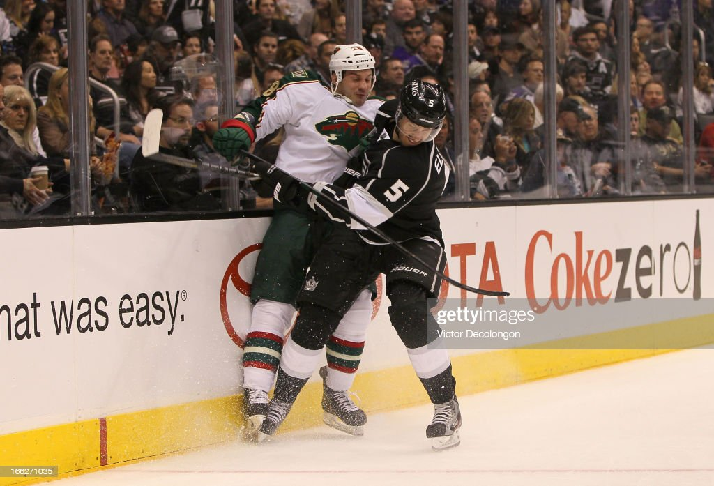 <a gi-track='captionPersonalityLinkClicked' href=/galleries/search?phrase=Keaton+Ellerby&family=editorial&specificpeople=4111546 ng-click='$event.stopPropagation()'>Keaton Ellerby</a> #5 of the Los Angeles Kings checks <a gi-track='captionPersonalityLinkClicked' href=/galleries/search?phrase=Zenon+Konopka&family=editorial&specificpeople=2105876 ng-click='$event.stopPropagation()'>Zenon Konopka</a> #28 of the Minnesota Wild at the end boards during their NHL game at Staples Center on April 4, 2013 in Los Angeles, California. The Kings defeated the Wild 3-0.