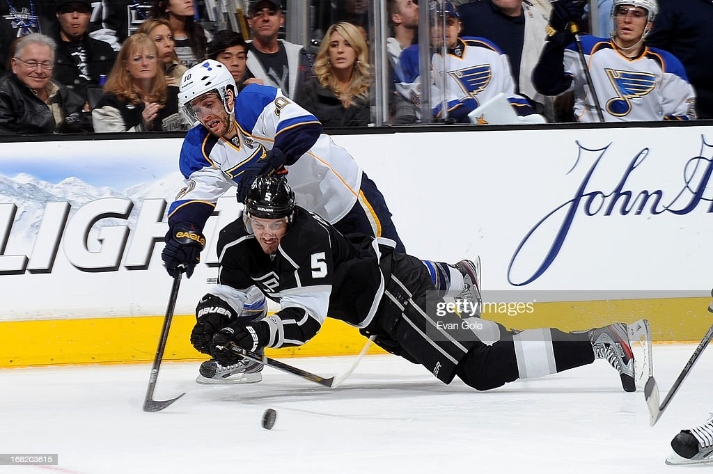 Keaton Ellerby #5 of the Los Angeles Kings fights for possession of the puck against Andy McDonald #10 of the St. Louis Blues in Game Four of the Western Conference Quarterfinals during the 2013 NHL Stanley Cup Playoffs at Staples Center on May 6, 2013 in Los Angeles, California.