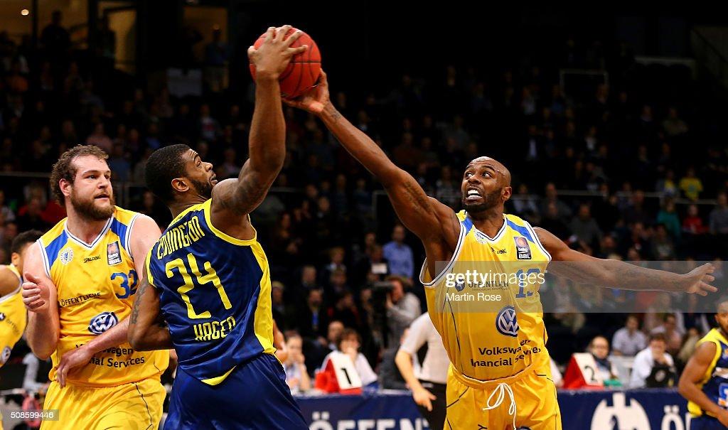 Keaton Grant of Braunschweig challenges Darius Covington of Hagen during the Bundesliga basketball game between Basketball Loewen Braunschweig and...