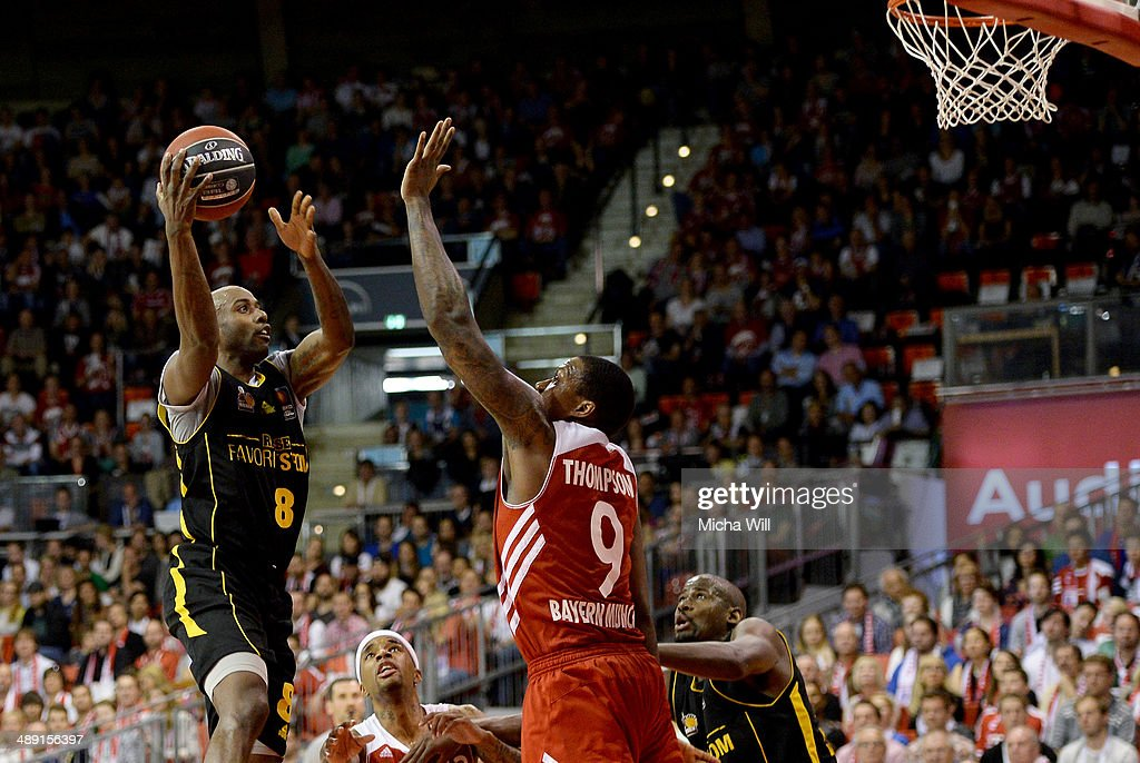 Keaton Grant of Ludwigsburg is challenged by Deon Thompson of Muenchen during game one of the 2014 Beko BBL Playoffs semifinals between FC Bayern...
