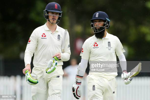 Keaton Jennings and Moeen Ali of England leave the field at the lunch break during the Two Day tour match between the Cricket Australia CA XI and...