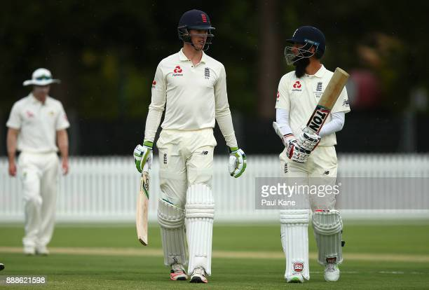 Keaton Jennings and Moeen Ali of England walk from the wicket area for a drinks break during the Two Day tour match between the Cricket Australia CA...