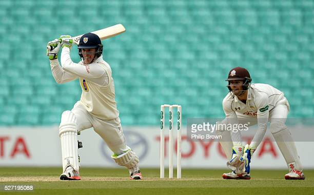 Keaton Jennings of Durham bats watched by Ben Foakes of Surrey during day two of the Specsavers County Championship Division One match between Surrey...