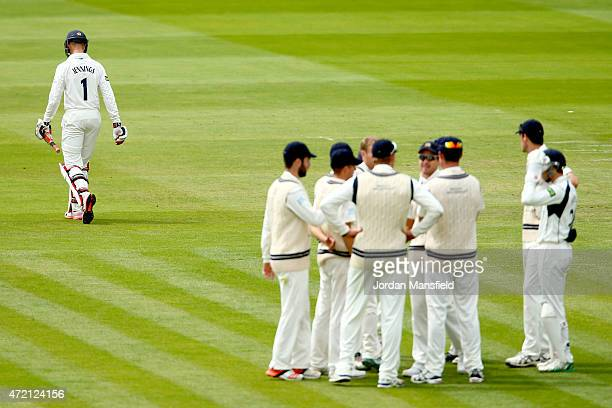 Keaton Jennings of Durham walks off the field as Middlesex celebrate after Adam Voges bowls him out during day three of the LV County Championship...