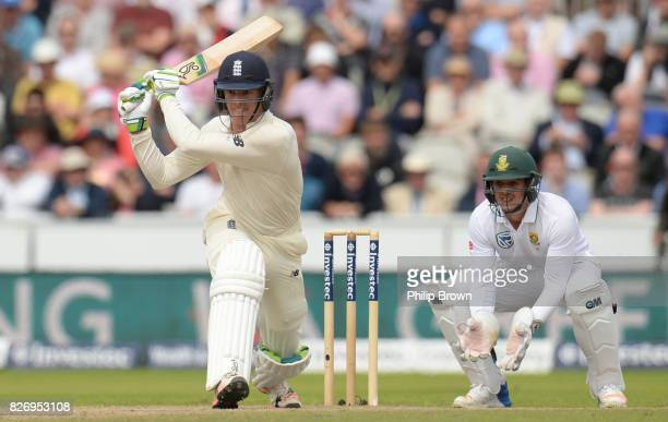 Keaton Jennings of England bats as Quinton de Kock of South Africa looks on during the third day of the 4th Investec Test match between England and...