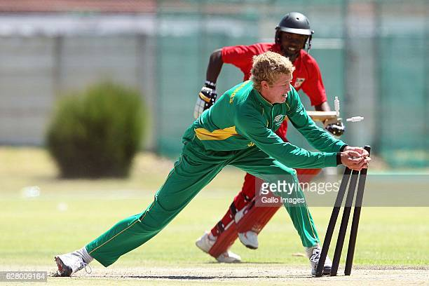 AFRICA JANUARY 23 Keaton Jennings runs out Peacemare Zinwa during the U19 Twenty20 series match between South Africa and Zimbabwe at Northerns...