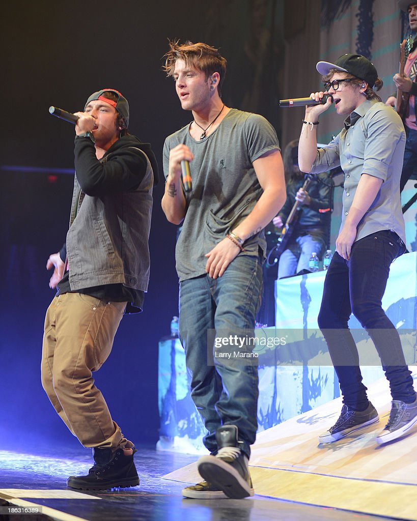 Keaton Stromberg, Drew Chadwick and Wesley Stromberg of Emblem3 perform at BB&T Center on October 29, 2013 in Sunrise, Florida.