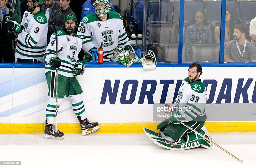 Keaton Thompson and Cam Johnson both of North Dakota Fighting Hawks take a break between whistles of a game against the Denver Pioneers during game...