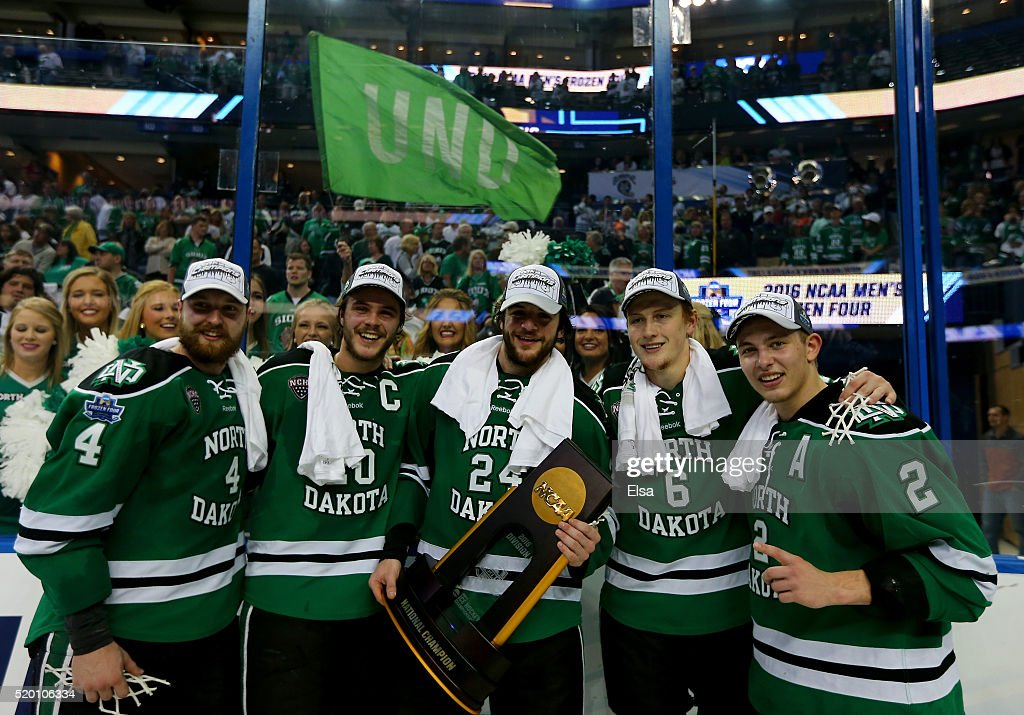 Keaton ThompsonGage AusmusChristian WolaninPaul LaDue and Troy Stecher of the North Dakota Fighting Hawks pose with the championship trophy after the...