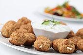 Roast meatballs on skewers and tzatziki dip. Shallow DOF