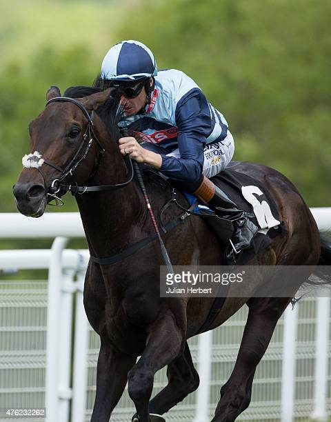 Keble ridden by Richard Hughes leads the field home to win the 1425 The Sunday School Maiden Stakes Race run at Goodwood Racecourse on June 7 2015...